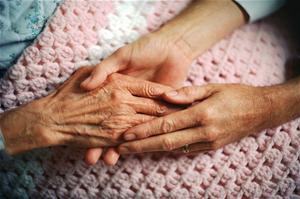 Elderly Hand Being Held